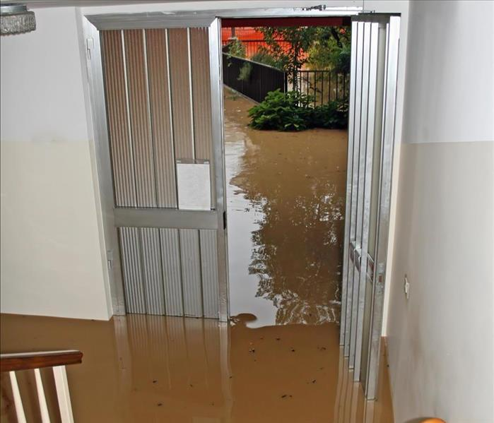 Entrance of a home with flooded water