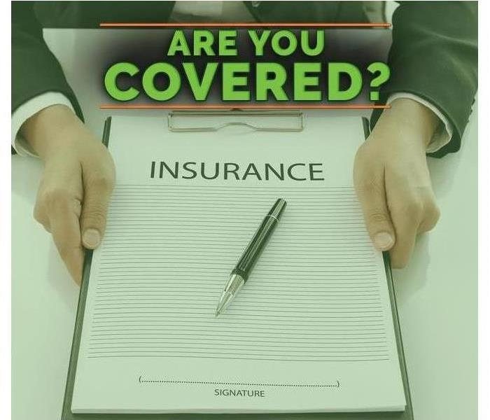 Hands holding a clipboard with insurance paperwork / Text on image that says ARE YOU COVERED?